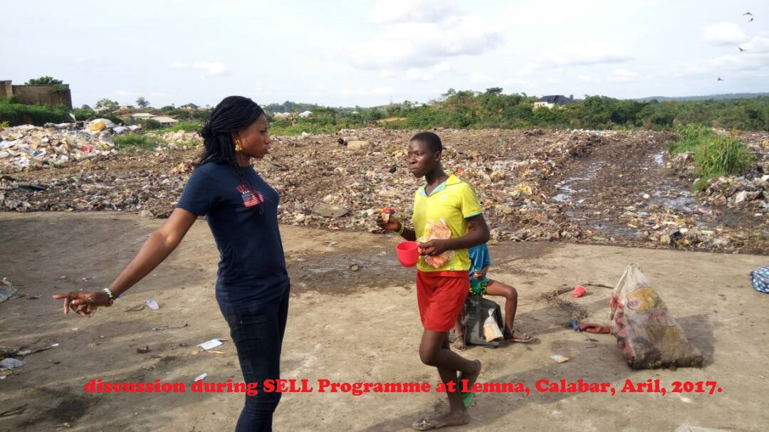 Mary and one of the Skolombo Children having one.-on- One discussion during SELL Programme at Lemna, Calabar, Aril, 2017.