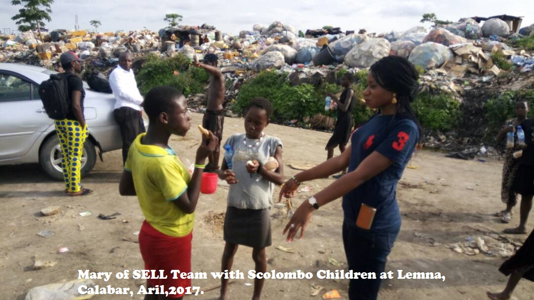 Mary of SELL Team with Scolombo Children at Lemna, Calabar, Aril,2017.